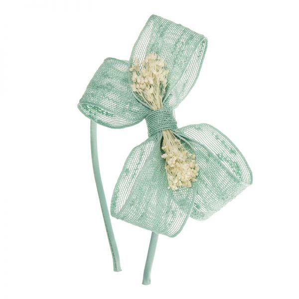 Diadema con lazo mariposa de rafia y flor natural
